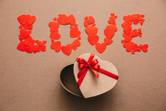 Word Love from hearts and open gift box in the shape of a heart. Stock Image