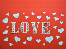 Word LOVE and hearts. Paper cutting. Royalty Free Stock Images