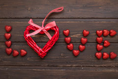 Word Love from the hearts. On a wooden background Royalty Free Stock Photography