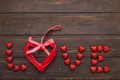 Word Love from the hearts. On a wooden background Stock Photos