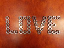 The word love of hex nuts. Geometric love pattern lined hex nuts royalty free stock images