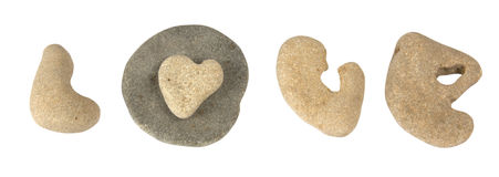 The word  Love laid out of the sea pebbles Royalty Free Stock Images