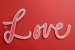 The word, LOVE, in letters on a red background Royalty Free Stock Images