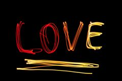 Word LOVE from light painting in the dark Royalty Free Stock Photography