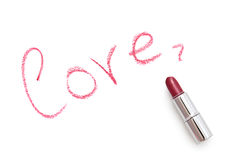 The word love with lipstick. Inscription love on a white background. The inscription is made using lipstick Royalty Free Stock Images