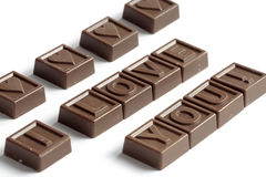 Word Love made of chocolates. Word Love made of little chocolates Royalty Free Stock Photo
