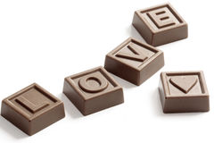 Word Love made of chocolates. Word Love made of little chocolates Royalty Free Stock Photos