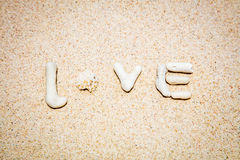 Word LOVE made of corals on sand, Boracay Island, Philippines Stock Photo