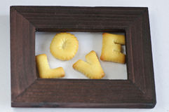 Word LOVE made of crackers is in the frame Stock Photo