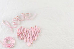 Word love made out of pink thread Stock Photo