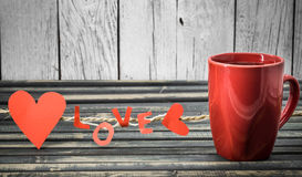 word love made of paper and red Cup Royalty Free Stock Image