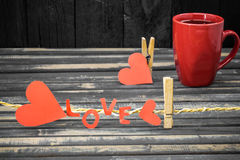 word love made of paper and red Cup Royalty Free Stock Images
