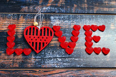 The word LOVE made of red candies and heart Royalty Free Stock Photography