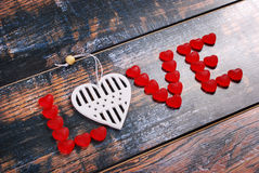The word LOVE made of red candies and white heart Royalty Free Stock Photos