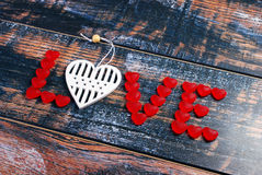 The word LOVE made of red candies and white heart Royalty Free Stock Image