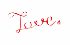 Word love made of red ribbon Royalty Free Stock Image