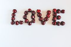 The word Love made of red sweet cherries. stock photo
