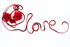 Word Love made from ribbon with roses, top wiew, isolate in hite background royalty free stock photography