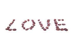 The word LOVE made of roasted coffee bean on white background Royalty Free Stock Images