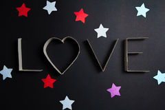 The word love made up of cardboard letters Stock Images
