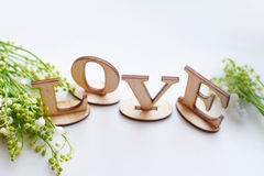 Word love made up with wooden letters on the table Royalty Free Stock Photos