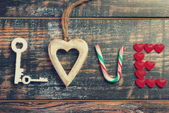 The word LOVE made of various objects in vintage style Stock Images