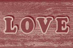 Word love made of wooden letters. On wooden board stock photos