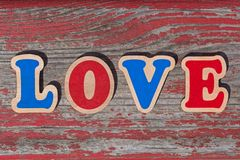 Word love made of wooden letters. On wood board royalty free stock image