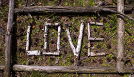 Word love from old birch branches in a frame of old trees Stock Images