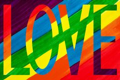Free Word LOVE On Rainbow Colors Background Close Up, LGBT Community Flag Backdrop, LGBTQ Pride Pattern, Love Sign, Gay, Lesbian Symbol Stock Images - 173314844
