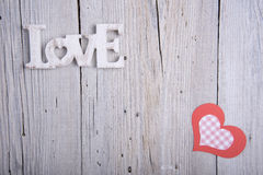 Word LOVE and paper heart Royalty Free Stock Image