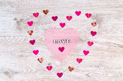 Word Love with paper Hearts shaped Valentines Day on white wooden background Royalty Free Stock Photography