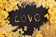 Word Love from pasta on the black background Royalty Free Stock Photo