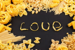 Word Love from pasta on the black background Royalty Free Stock Photos