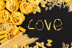 Word Love from pasta on the black background Royalty Free Stock Image