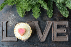 The Word Love and A Pie Cupcake Part of Tree On Rustic Metal Bac Royalty Free Stock Images