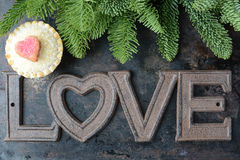 The Word Love and A Pie Cupcake Part of Tree On Rustic Metal Bac Royalty Free Stock Photography