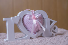 Word love and pink handmade hearts Royalty Free Stock Photos