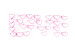 Word love from pink sweets isolated Royalty Free Stock Photos