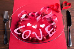 The word love on a plate on a brown table Royalty Free Stock Photos