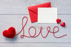 Word love and red envelope with letter Royalty Free Stock Photos