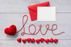 Word love and red envelope with letter Royalty Free Stock Photography