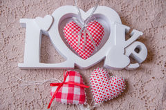 Word love and red handmade hearts Stock Photography