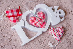 Word love and red handmade hearts Royalty Free Stock Images