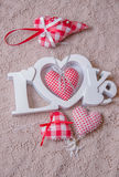 Word love and red handmade hearts Royalty Free Stock Photo