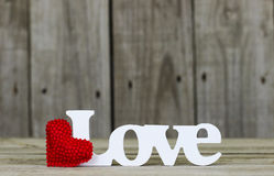 The word Love with red heart and wooden background Stock Photo