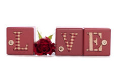 Word love with red rose Royalty Free Stock Images