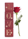 Word love with red rose Royalty Free Stock Photos