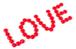 Word love from red sweets isolated on white Stock Photos
