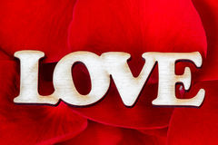 Word Love with rose petals. Sweet holiday background. Valentines Day Card. Closeup Stock Photography